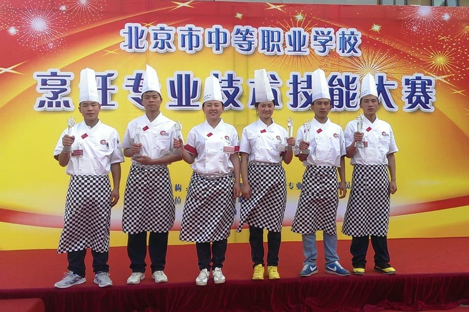 Student winners of Lee Kum Kee Hope as Chef project in the China Beijing City Middle Vocational School Professional Cooking Competition.